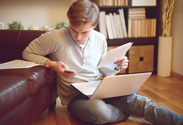 attractive young man in home interior stock photo