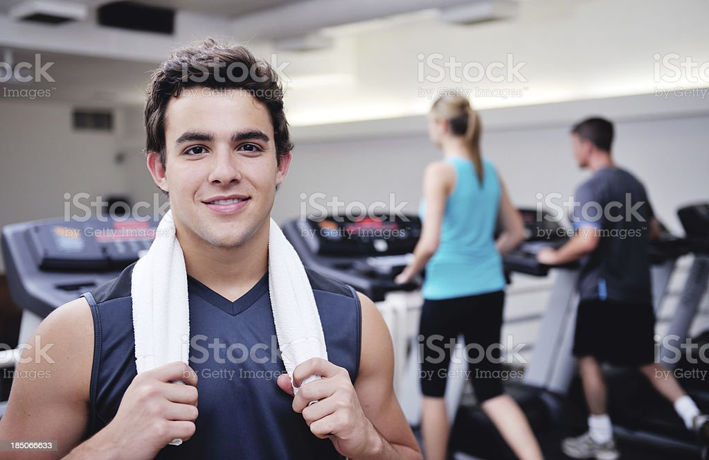 Attractive Young Man in the Fitness Club stock photo