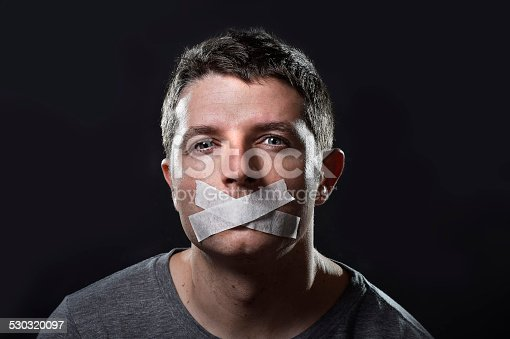 istock attractive young man  mouth sealed on adhesive  tape 530320097