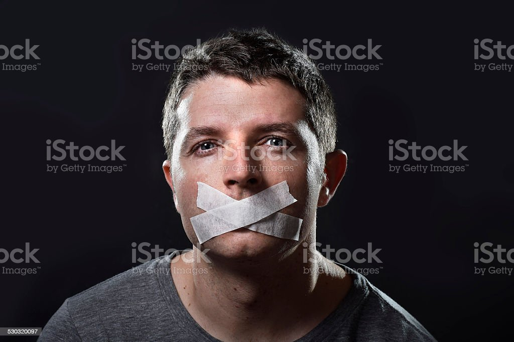 attractive young man  mouth sealed on adhesive  tape stock photo