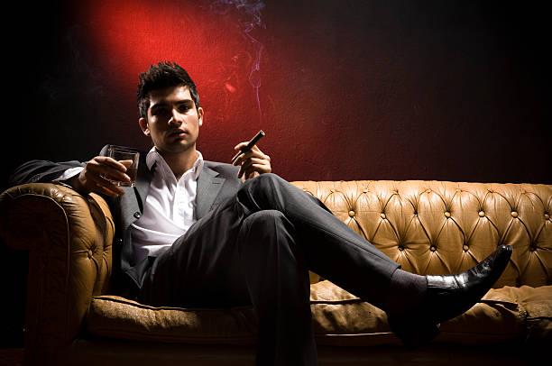 attractive young man - guy with cigar stockfoto's en -beelden