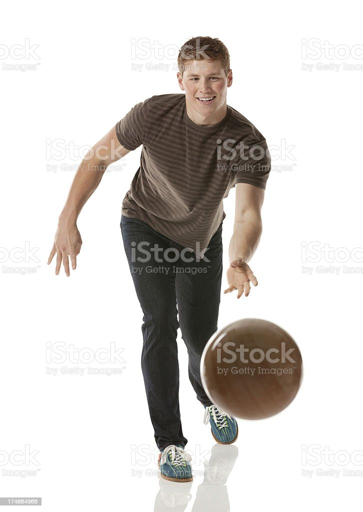 Attractive young man playing with a bowling ball royalty-free stock photo