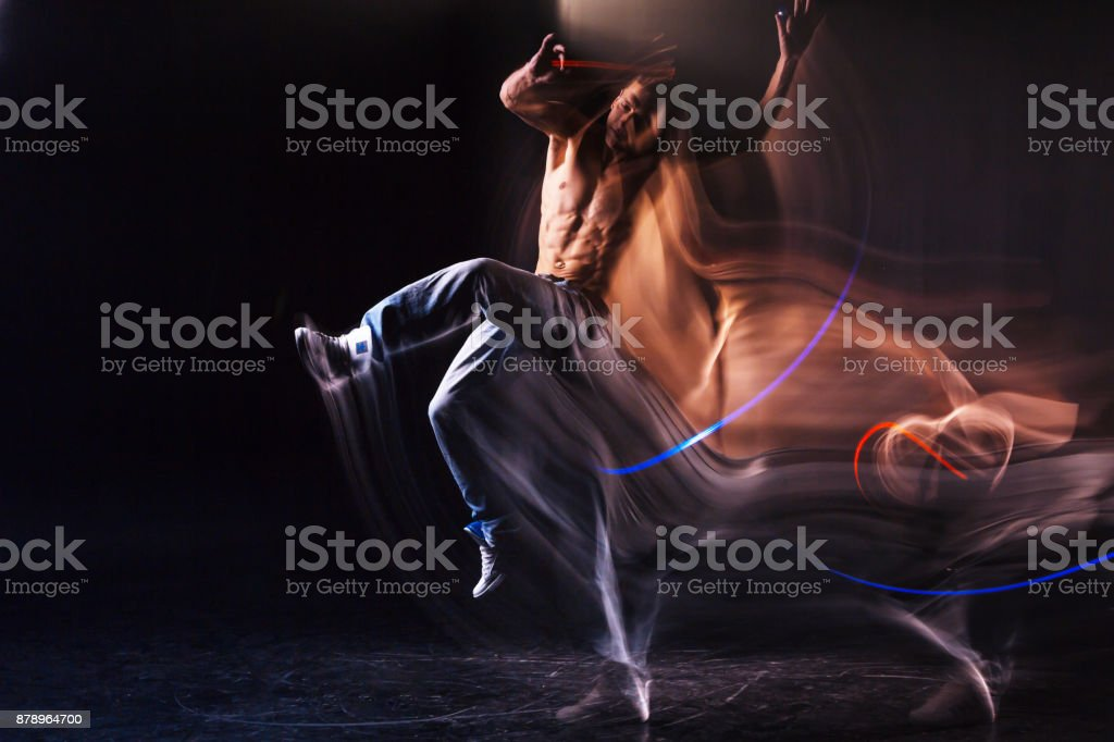 Attractive young man showing his dance stock photo