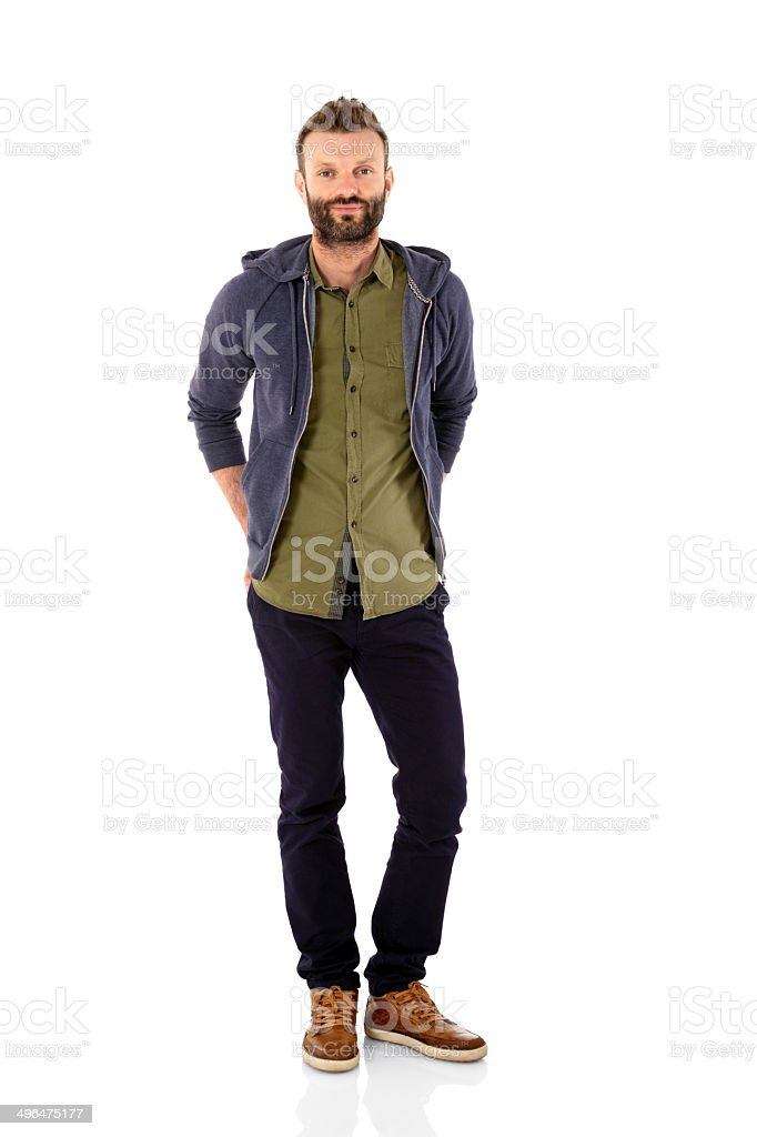 Attractive young man standing relaxed on white background stock photo