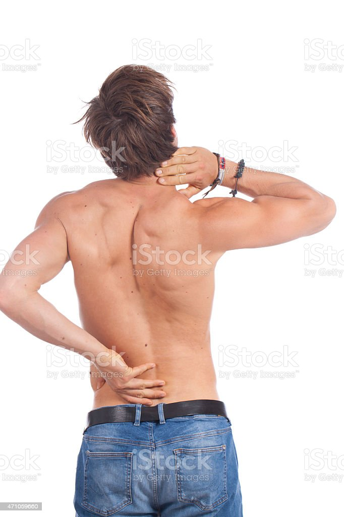 Attractive young man with back pain stock photo