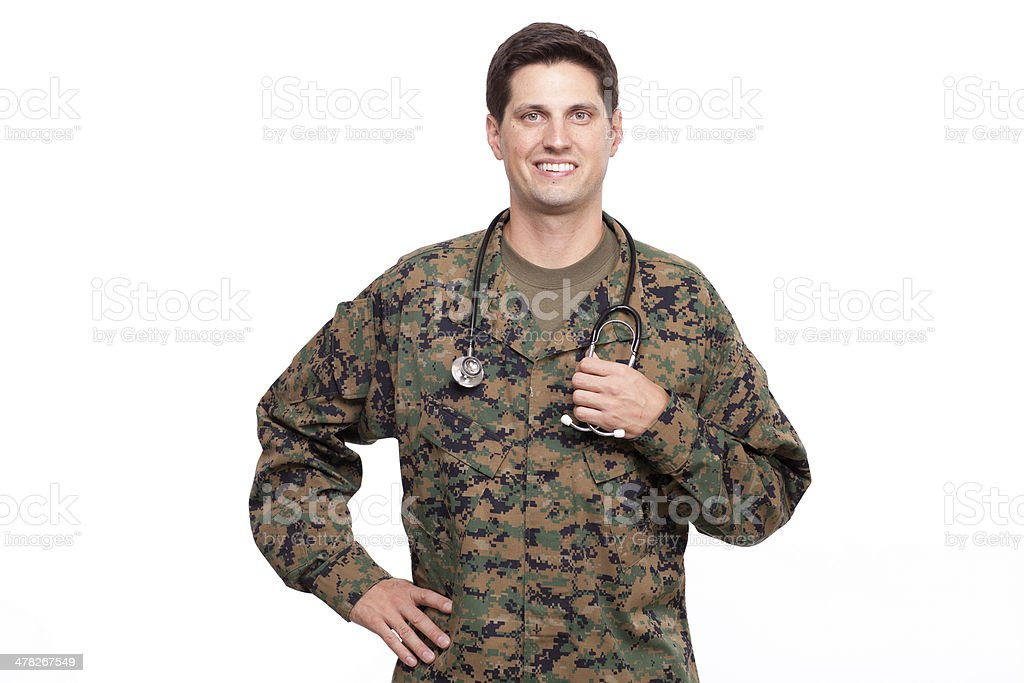 attractive young military doctor with hand on hip royalty-free stock photo