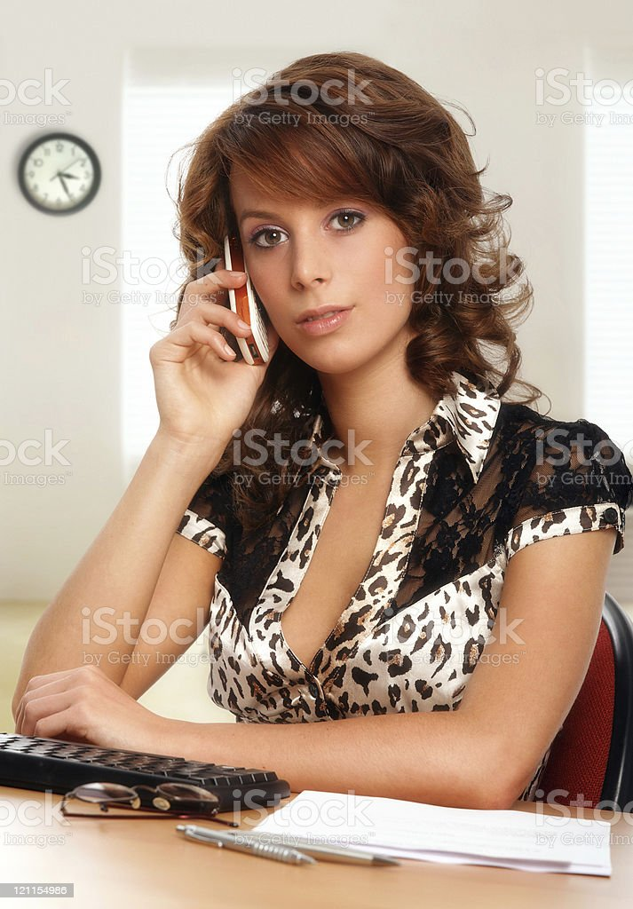 attractive young office worker talking on mobile phone royalty-free stock photo