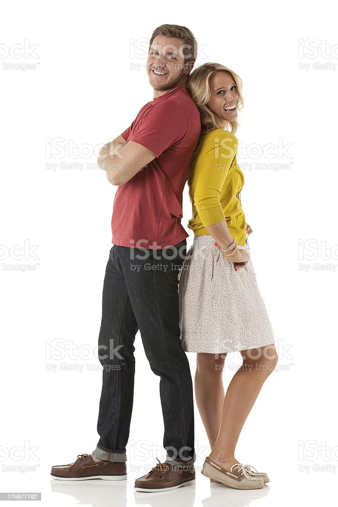 Attractive young romantic couple smiling stock photo