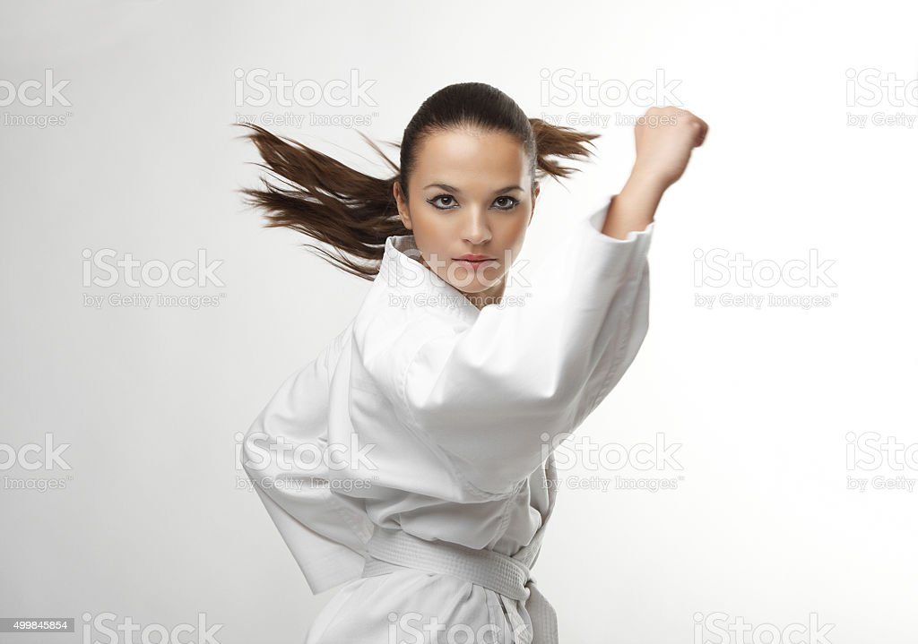 Attractive young sexy women in a karate pose stock photo