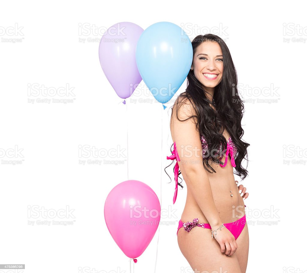 Attractive Young Smiling Brunette holding Colorful Balloons stock photo