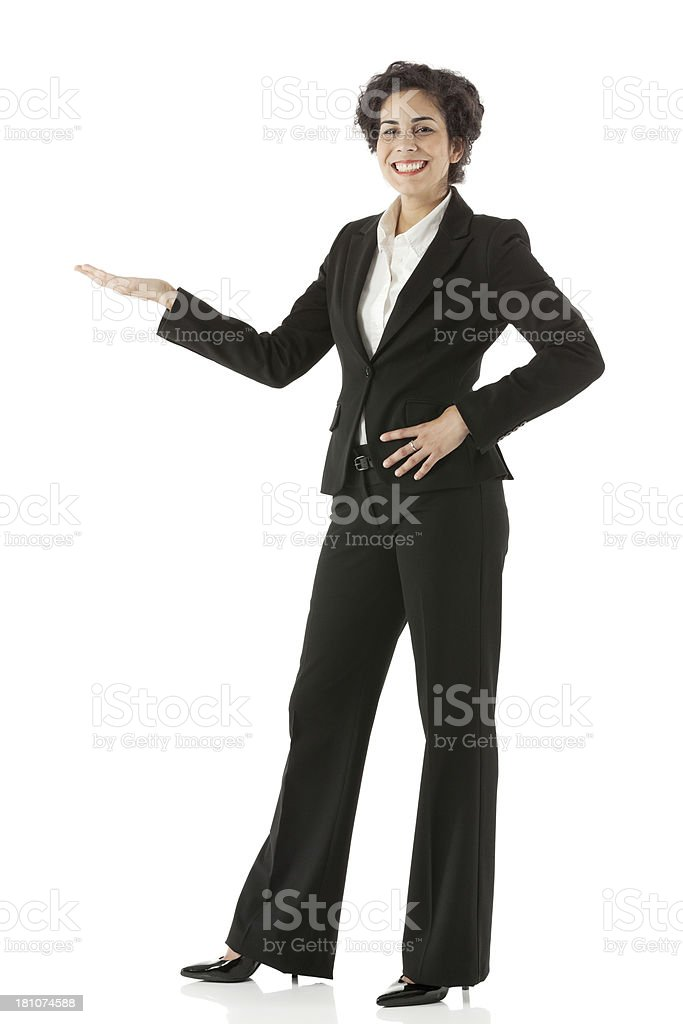 Attractive young smiling businesswoman gesturing royalty-free stock photo
