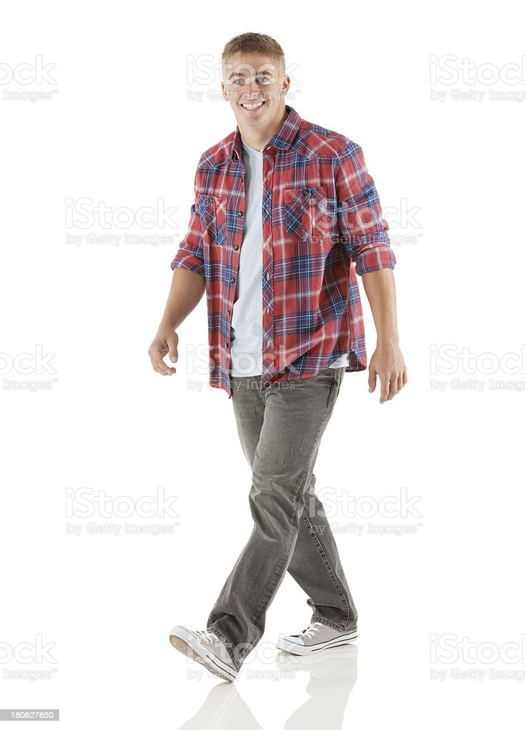 Attractive young smiling man walking royalty-free stock photo