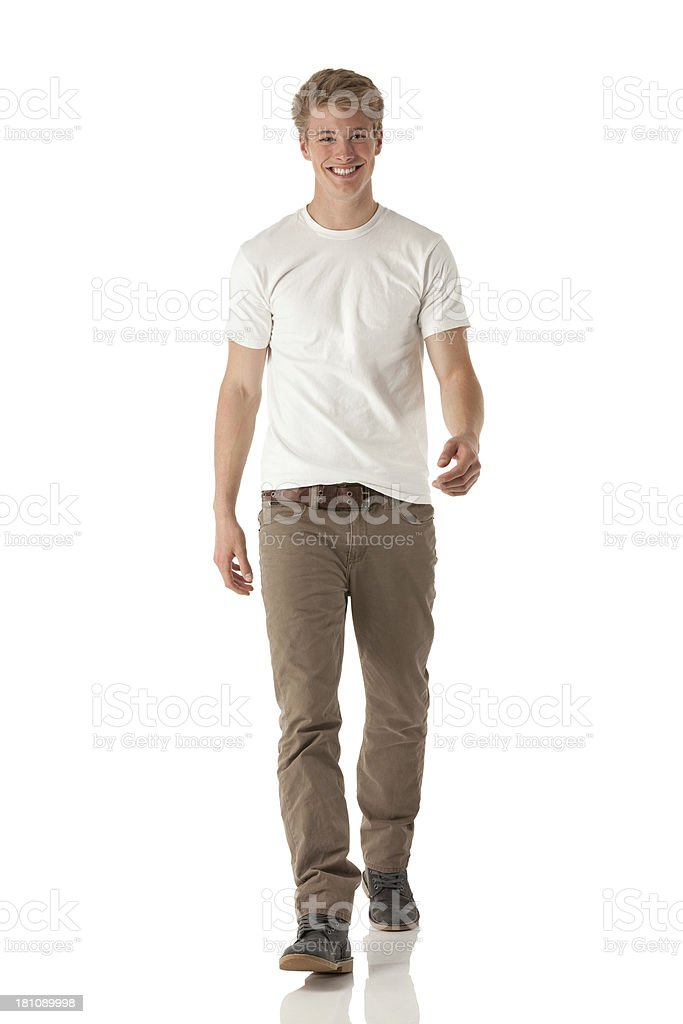 Attractive young smiling man walking stock photo