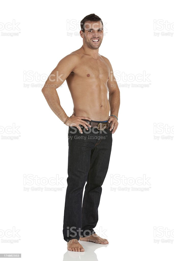 Attractive young smiling muscular man posing royalty-free stock photo