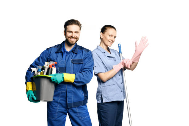 attractive young woman and man  in cleaning uniform and rubber gloves holding a broom cleaning products in his hands - custodian stock pictures, royalty-free photos & images