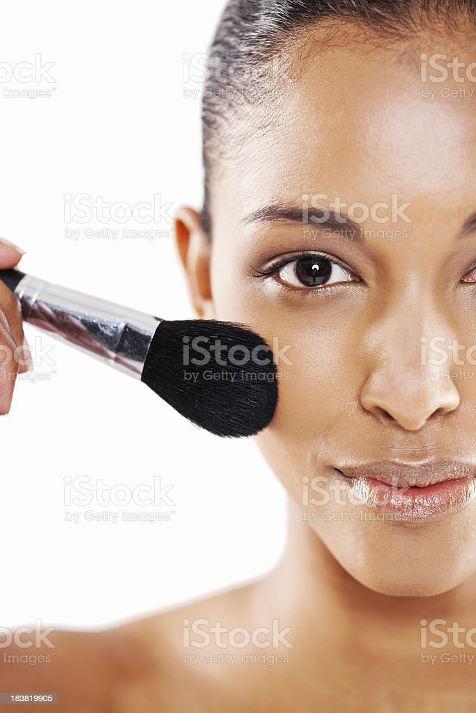 Attractive Young Woman Applying Make-up royalty-free stock photo