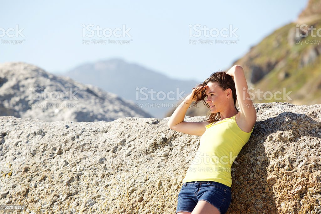Attractive young woman at the beach stock photo