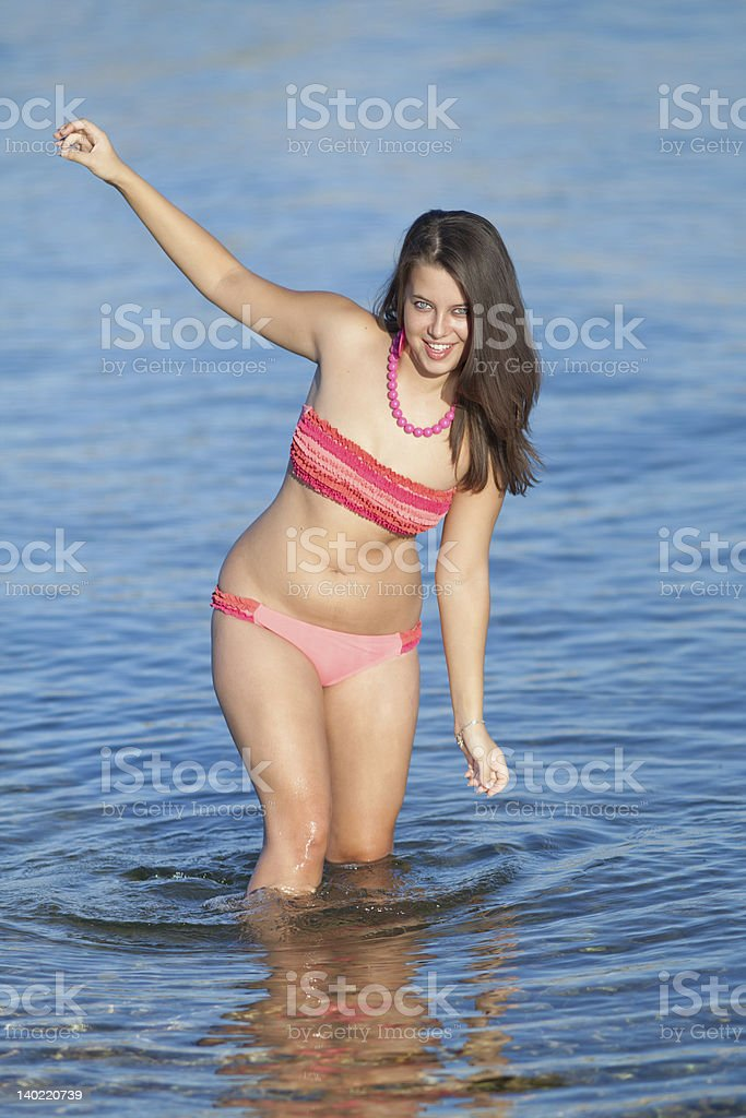 Attractive young woman at the sea stock photo