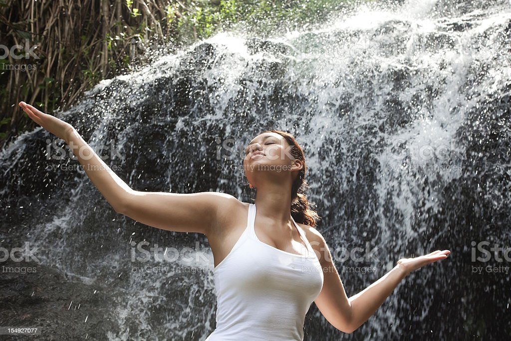 Attractive Young Woman at Waterfall stock photo