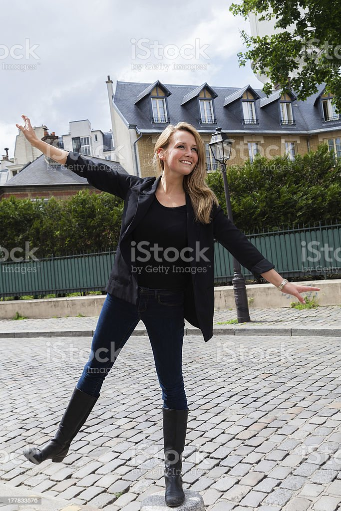 Attractive Young Woman Balancing on One Foot in Montmartre stock photo