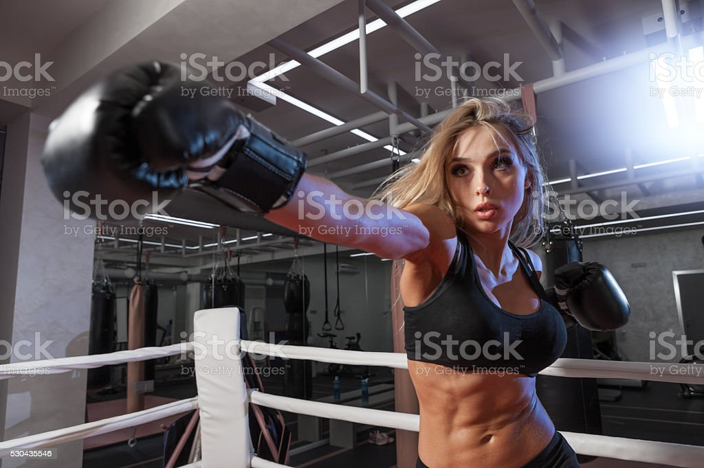 attractive young woman boxing at the gym stock photo
