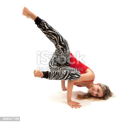 istock Attractive young woman breakdancing 508347169