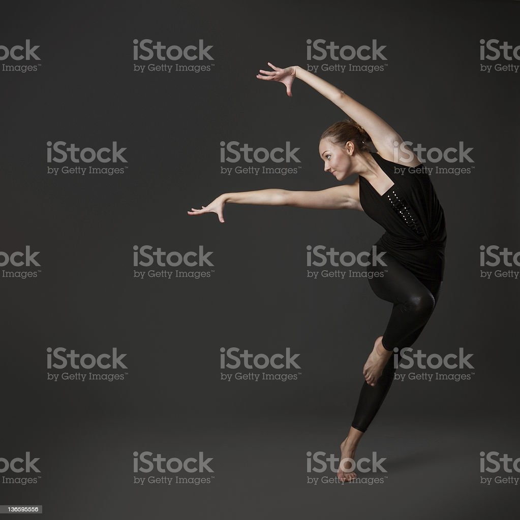 attractive young woman dancing stock photo