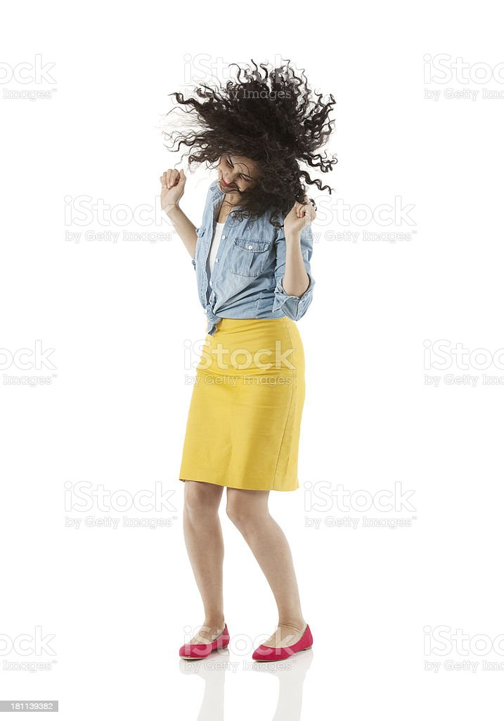 Attractive young woman dancing royalty-free stock photo