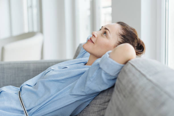 Attractive young woman deep in thought stock photo