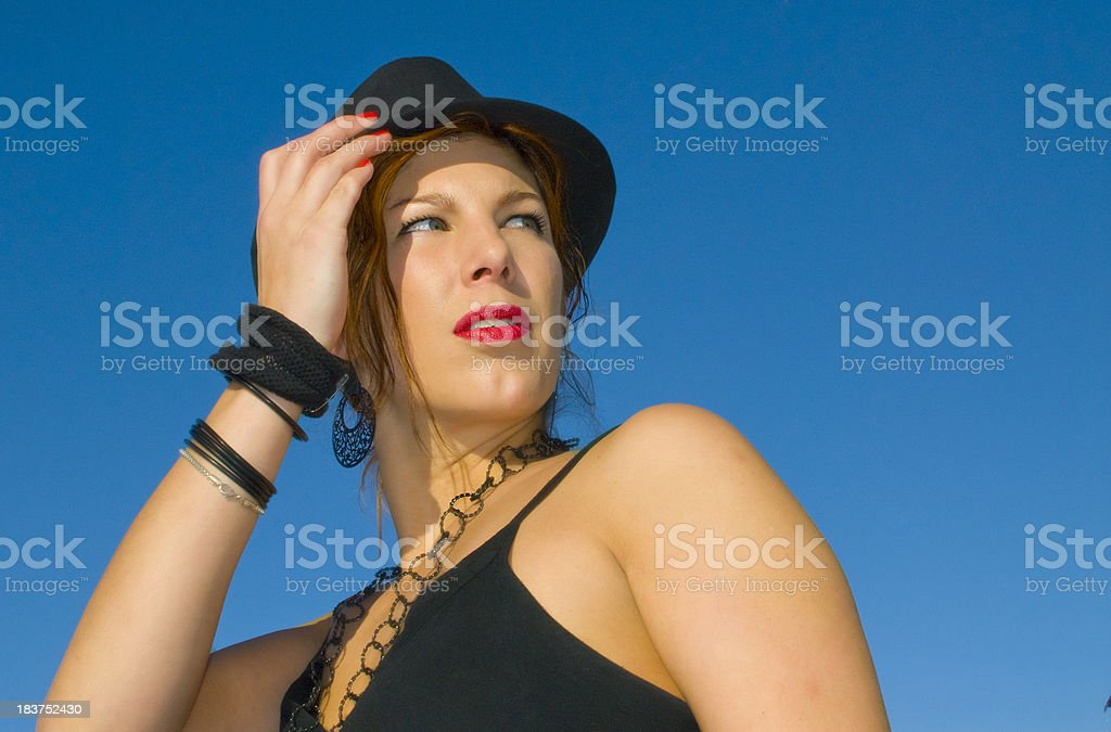 Attractive young woman diva with hat and red lips stock photo
