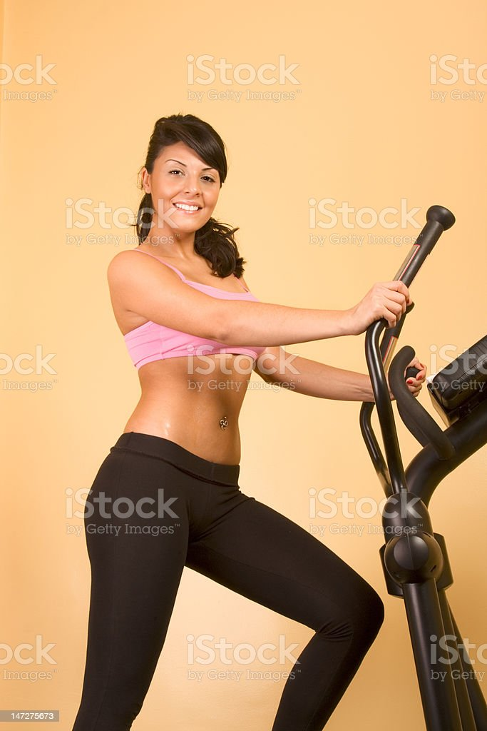 Attractive young woman doing cardio workout royalty-free stock photo