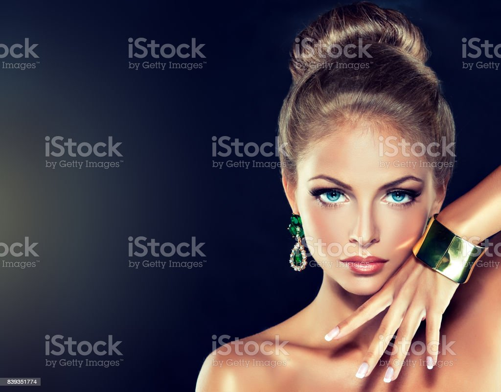 Attractive  young woman dressed in modern, fashionable jewelry. stock photo