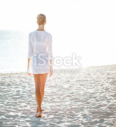 istock Attractive young woman  enjoying a day at the beach 523823772
