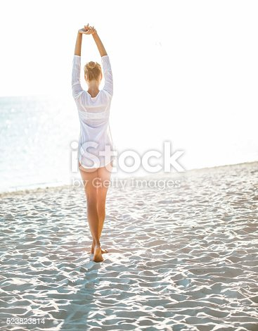Attractive young woman  enjoying a day at the beach