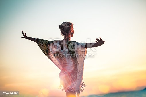 istock Attractive young woman  enjoying at the beach 524714948