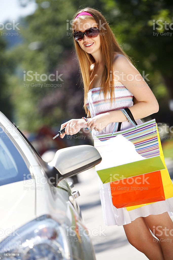 Attractive young woman entering car royalty-free stock photo