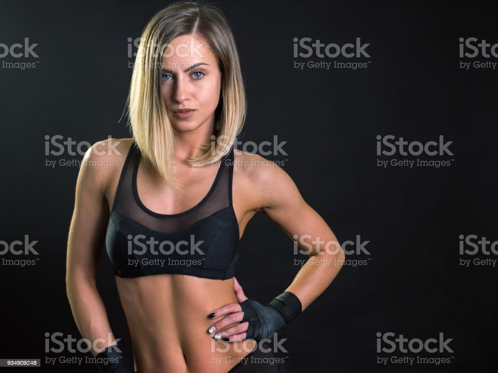 Attractive young woman fitness model posing looking at camera stock photo