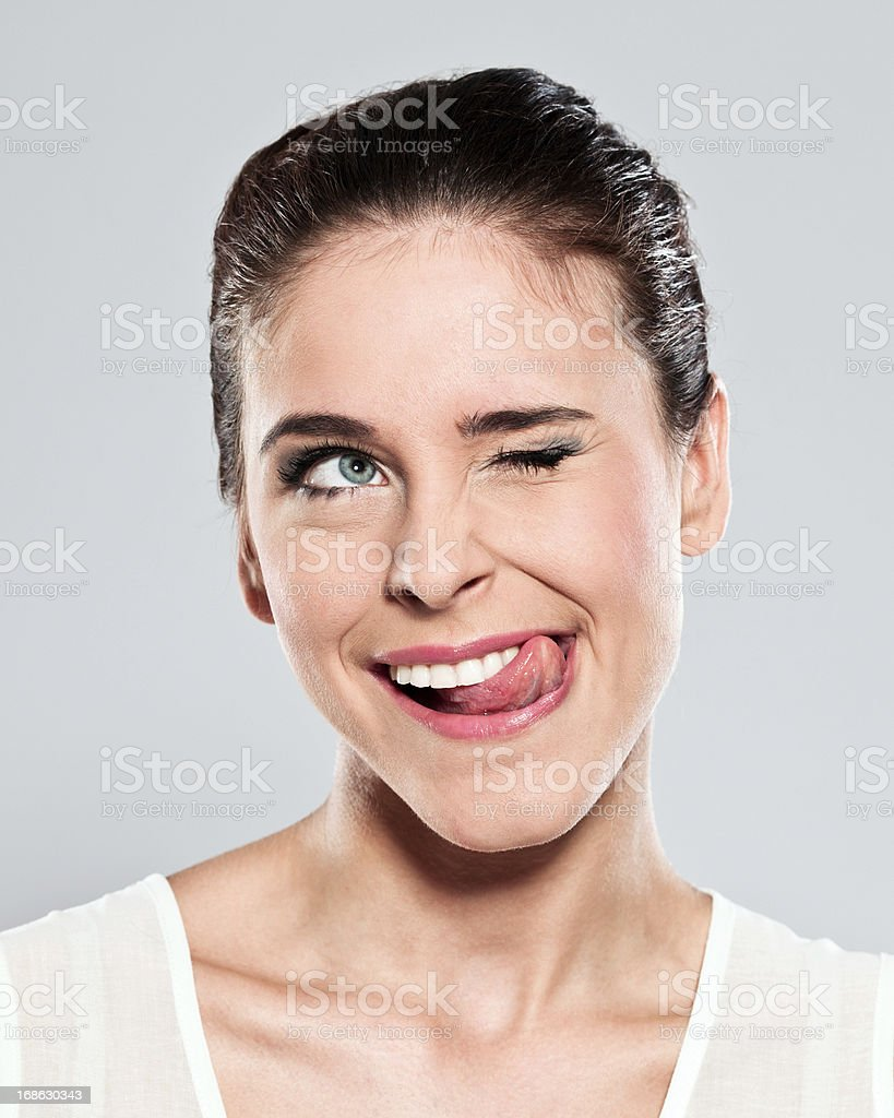 Attractive young woman grimacing stock photo