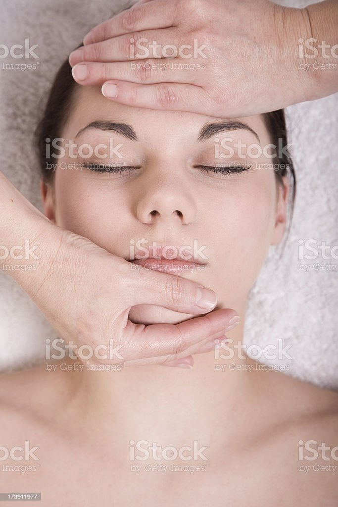 Attractive Young woman having reiki treatment royalty-free stock photo