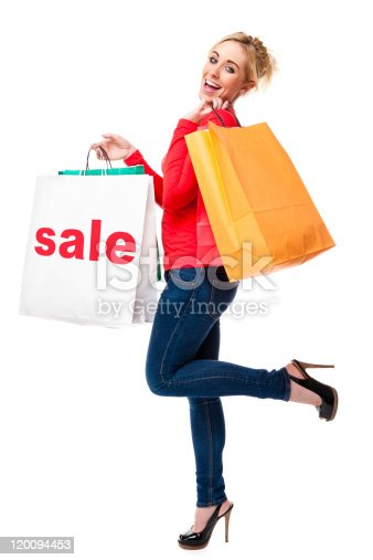 155097509 istock photo Attractive Young Woman Holding White Shopping Bag With Sale Sign 120094453