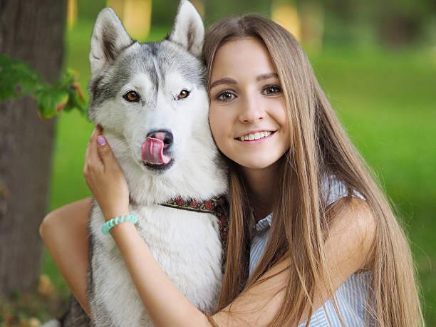 Attractive young woman hugs funny siberian husky dog picture id601365810?b=1&k=6&m=601365810&s=612x612&w=0&h=ikrwli90znftvjn oknildkxya8n3 qyygger4pq0ks=