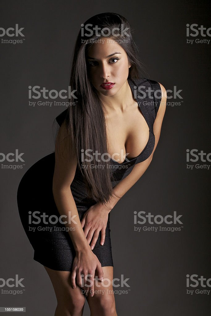 Attractive Young Woman in a Tight Dress stock photo