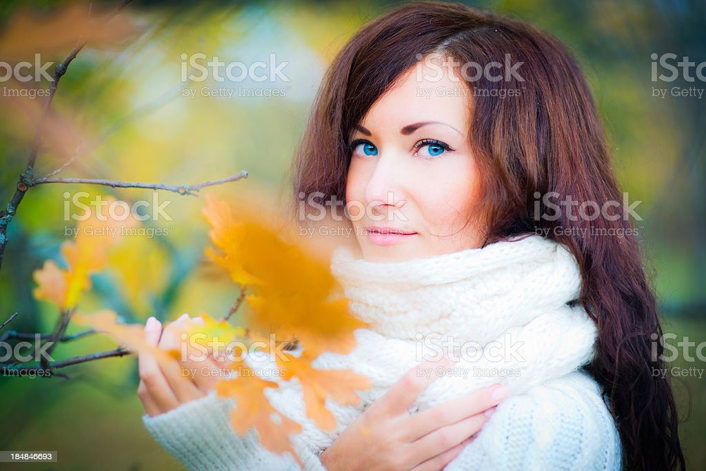 Attractive young woman in autumn park royalty-free stock photo