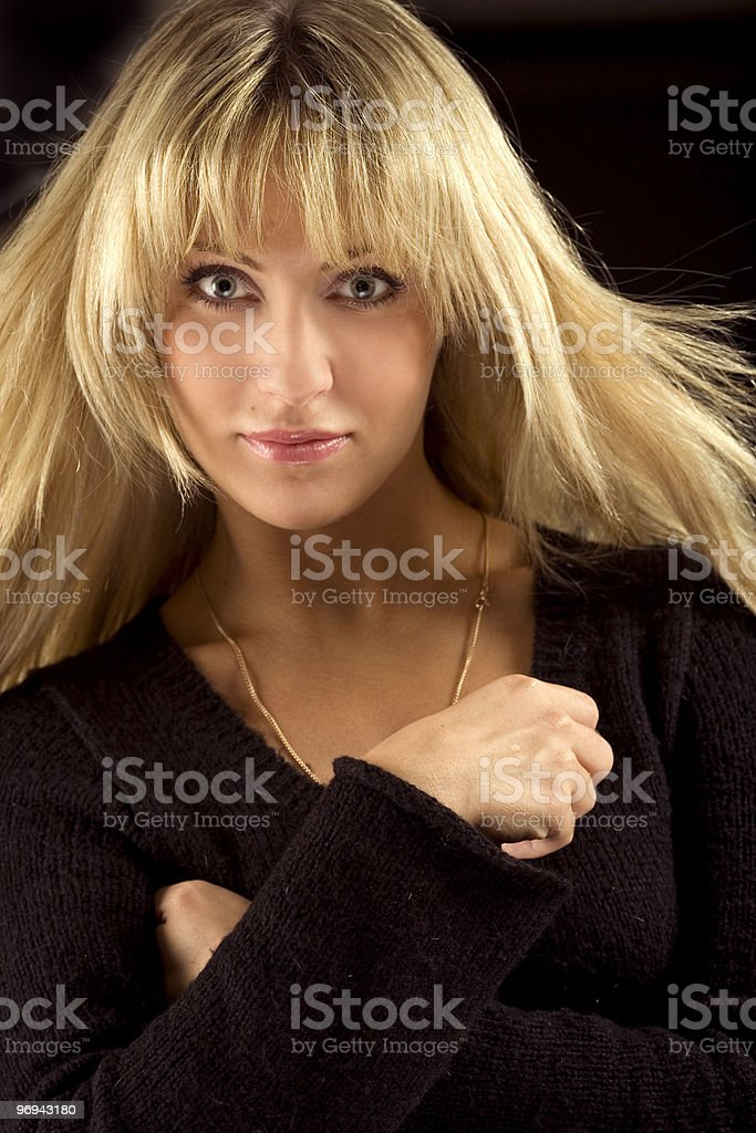 Attractive young woman in black royalty-free stock photo