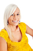 Photo of an attractive young blonde woman wearing braces with a bright smile.