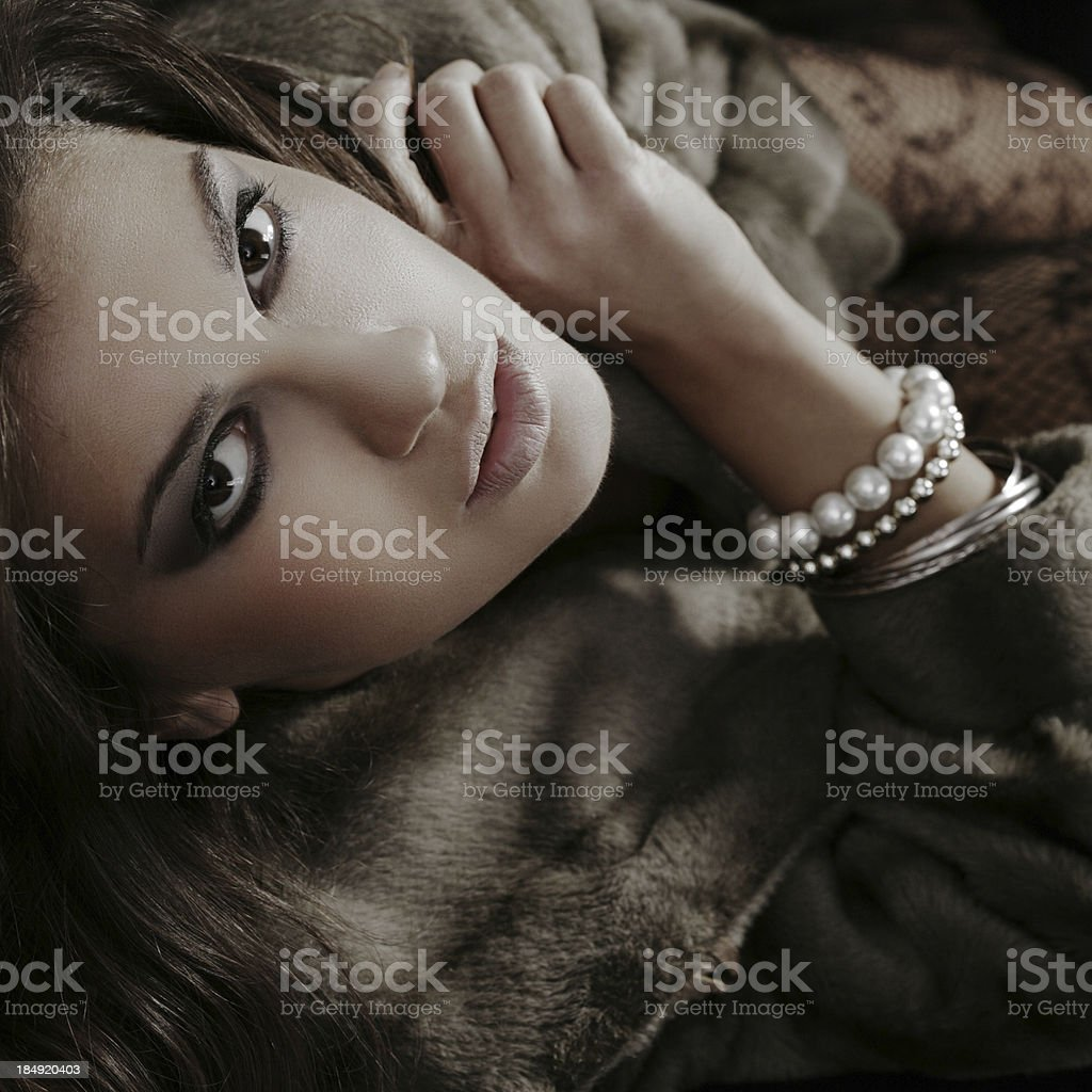 Attractive young woman in fur coat royalty-free stock photo