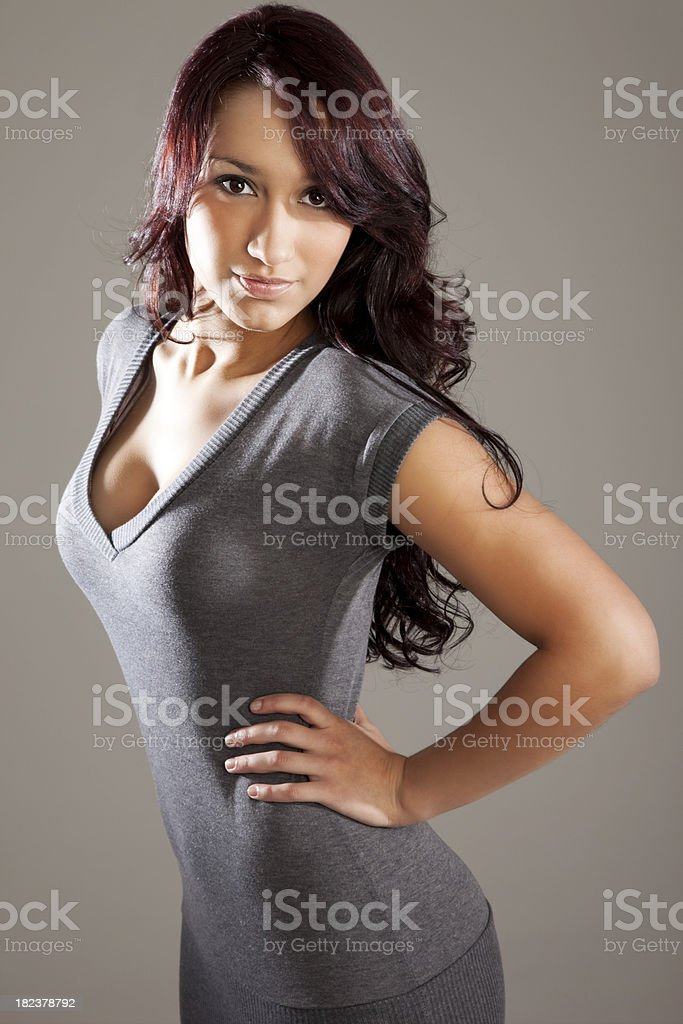 Attractive Young Woman in Gray Sweater Dress stock photo