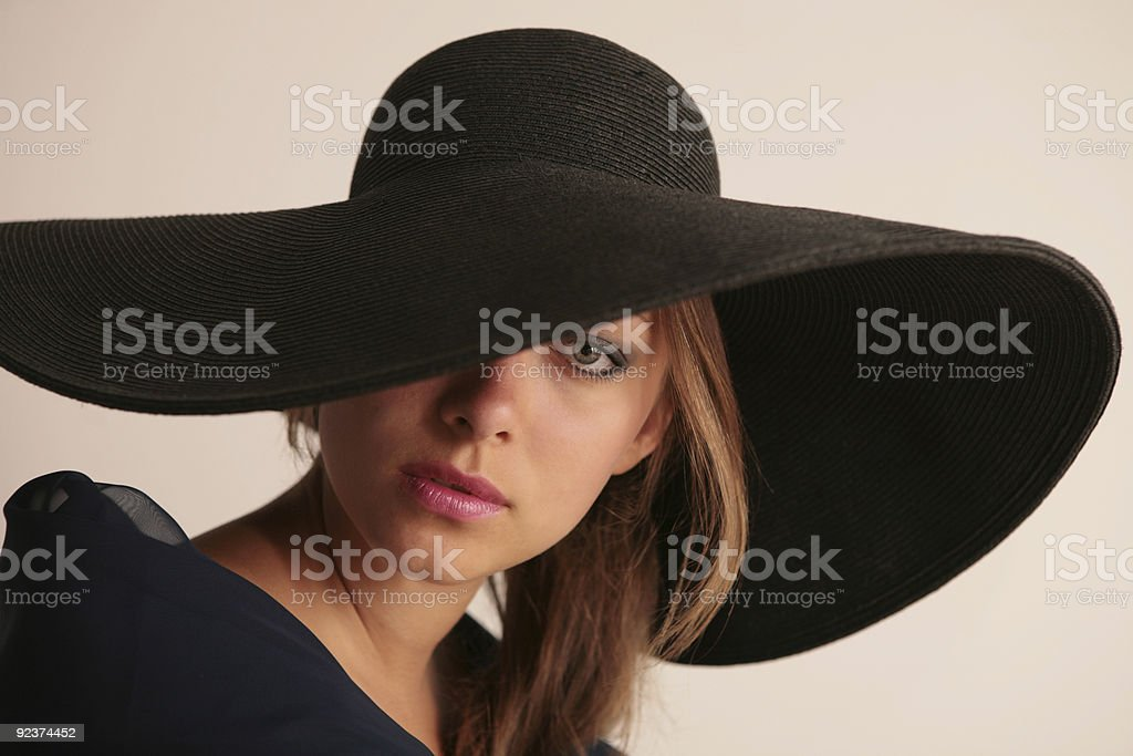 attractive young woman in hat royalty-free stock photo