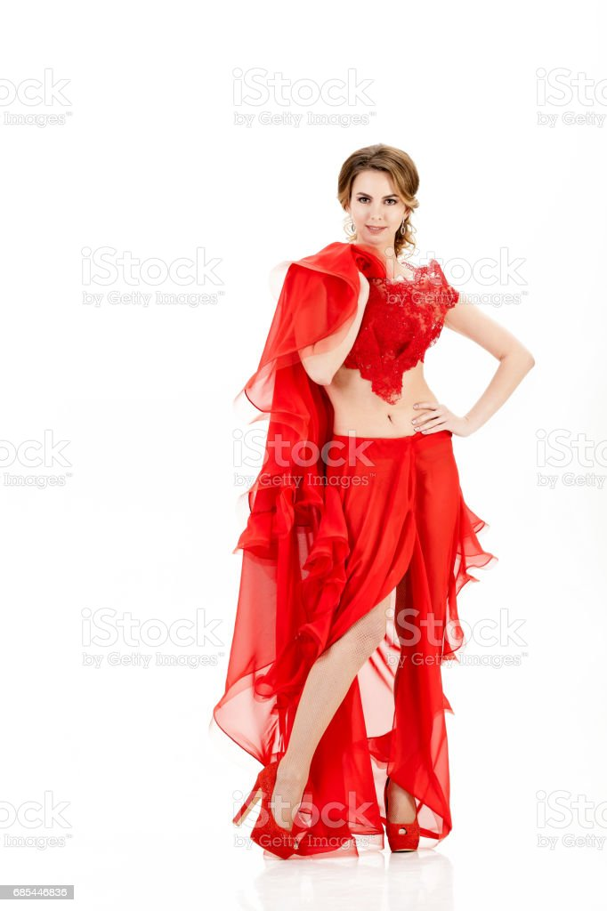 attractive young woman in red dress on white background foto de stock royalty-free