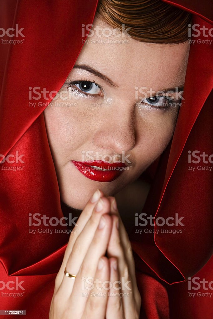 Attractive young woman in red hood royalty-free stock photo